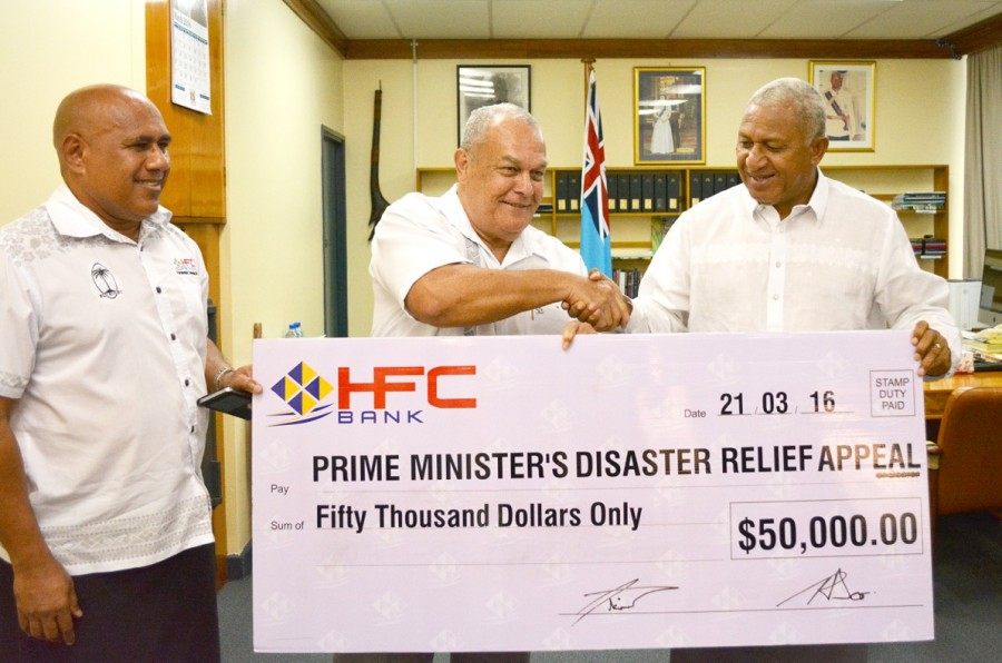 HFC Bank CEO - Mr.Isikeli Tikoduadua(left), Chairman Mr.Tom Ricketts (centre) present donation to PM
